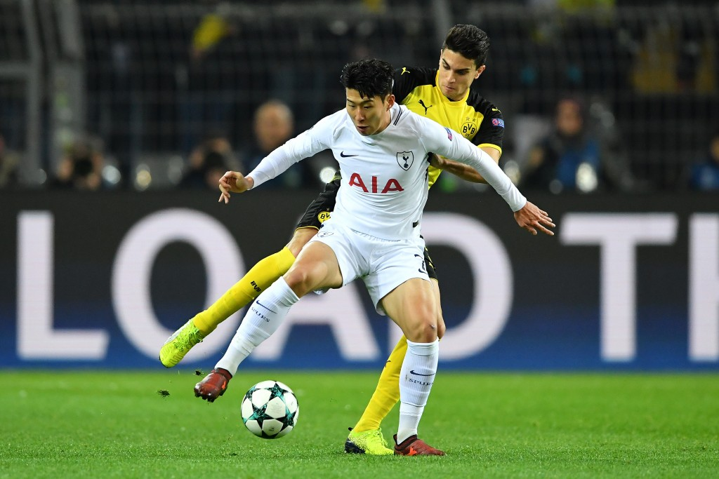 DORTMUND, GERMANY - NOVEMBER 21: Heung-Min Son of Tottenham Hotspur and Marc Bartra of Borussia Dortmund battle for possession during the UEFA Champions League group H match between Borussia Dortmund and Tottenham Hotspur at Signal Iduna Park on November 21, 2017 in Dortmund, Germany. (Photo by Stuart Franklin/Getty Images)