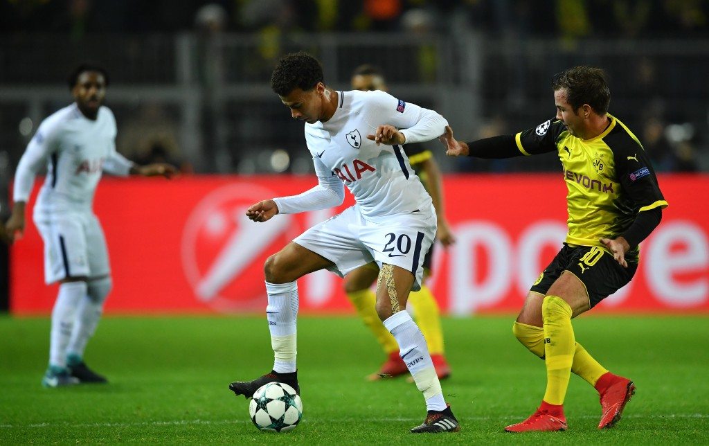 DORTMUND, GERMANY - NOVEMBER 21: Dele Alli of Tottenham Hotspur and Mario Gotze of Borussia Dortmund in action during the UEFA Champions League group H match between Borussia Dortmund and Tottenham Hotspur at Signal Iduna Park on November 21, 2017 in Dortmund, Germany. (Photo by Stuart Franklin/Getty Images)