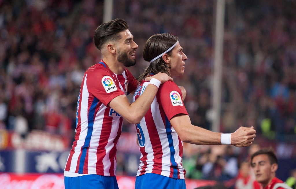 MADRID, SPAIN - APRIL 04: Felipe Luis of Club Atletico de Madrid celebrates with Yannick Carrasco after scoring his team's 1st goal during the La Liga match between Club Atletico de Madrid and Real Sociedad de Futbol at Vicente Calderon Stadium on April 4, 2017 in Madrid, Spain. (Photo by Denis Doyle/Getty Images)