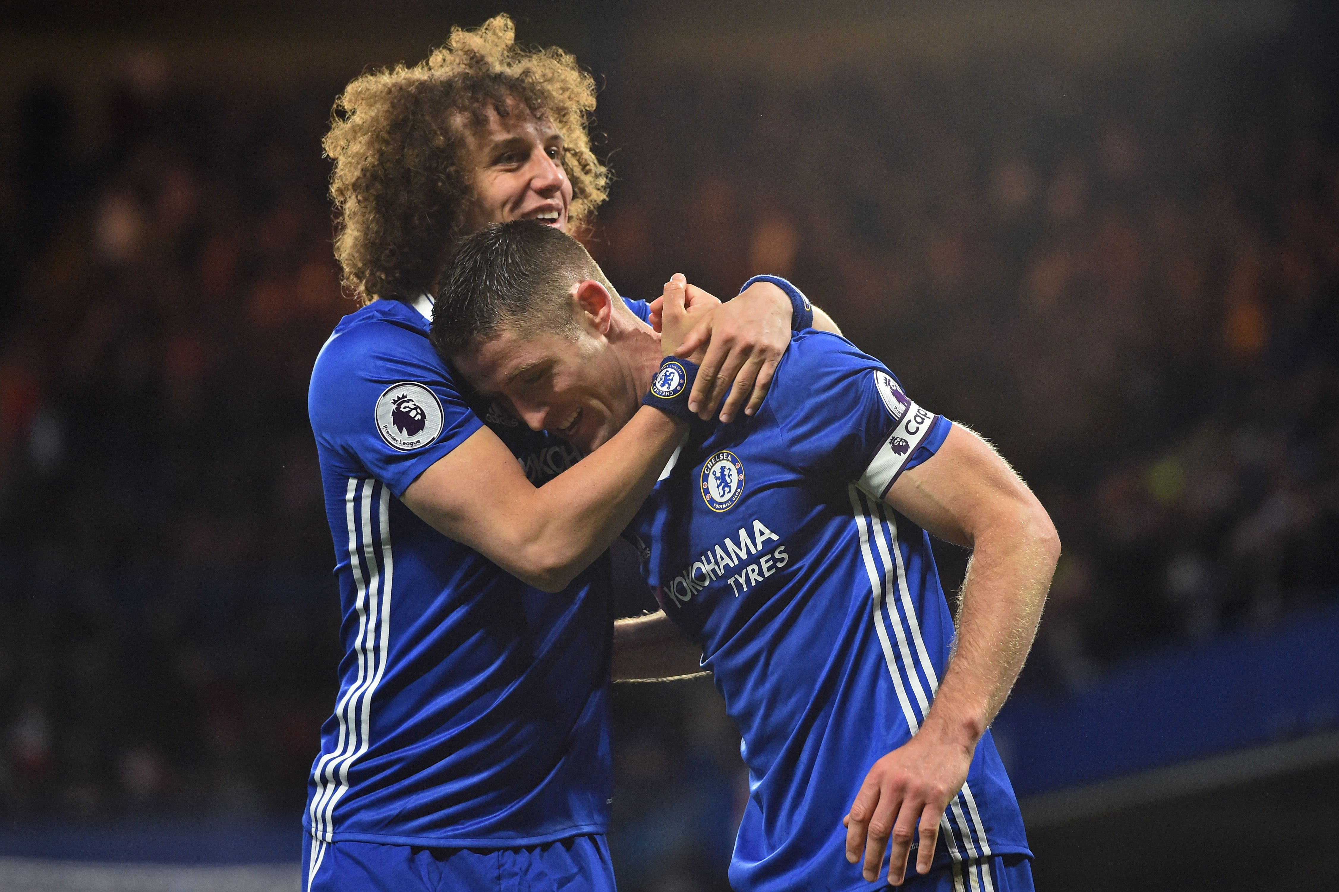 Chelsea's English defender Gary Cahill celebrates with Chelsea's Brazilian defender David Luiz (L) after scoring their second goal during the English Premier League football match between Chelsea and Southampton at Stamford Bridge in London on April 25, 2017. / AFP PHOTO / Glyn KIRK / RESTRICTED TO EDITORIAL USE. No use with unauthorized audio, video, data, fixture lists, club/league logos or 'live' services. Online in-match use limited to 75 images, no video emulation. No use in betting, games or single club/league/player publications. / (Photo credit should read GLYN KIRK/AFP/Getty Images)