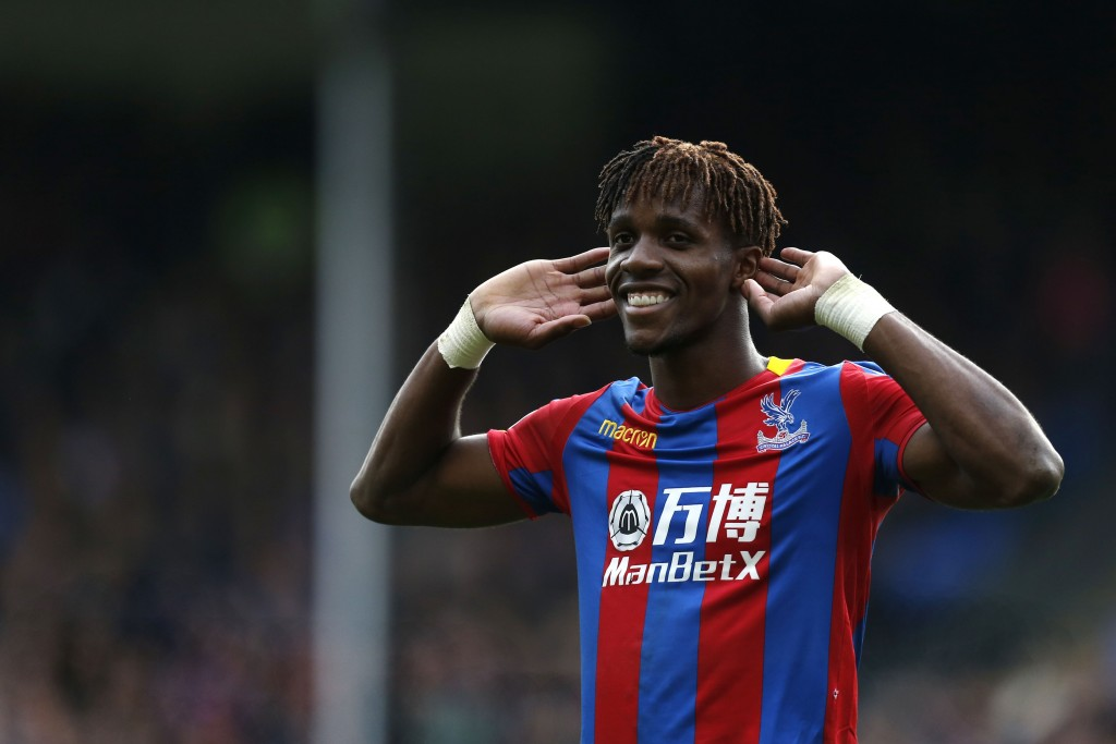 Crystal Palace's Ivorian striker Wilfried Zaha gestures to supporters during the English Premier League football match between Crystal Palace and West Ham United at Selhurst Park in south London on October 28, 2017. / AFP PHOTO / Ian KINGTON / RESTRICTED TO EDITORIAL USE. No use with unauthorized audio, video, data, fixture lists, club/league logos or 'live' services. Online in-match use limited to 75 images, no video emulation. No use in betting, games or single club/league/player publications.  /         (Photo credit should read IAN KINGTON/AFP/Getty Images)
