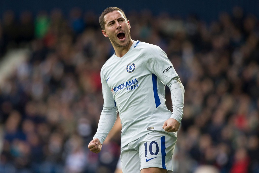 Chelsea's Belgian midfielder Eden Hazard celebrates scoring his team's second goal during the English Premier League football match between West Bromwich Albion and Chelsea at The Hawthorns stadium in West Bromwich, central England, on November 18, 2017. / AFP PHOTO / Roland Harrison / RESTRICTED TO EDITORIAL USE. No use with unauthorized audio, video, data, fixture lists, club/league logos or 'live' services. Online in-match use limited to 75 images, no video emulation. No use in betting, games or single club/league/player publications. / (Photo credit should read ROLAND HARRISON/AFP/Getty Images)