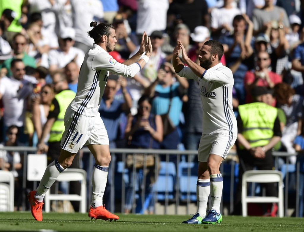 Real Madrid's Welsh forward Gareth Bale (L) and Real Madrid's defender Dani Carvajal celebrate after scoring a goal during the Spanish league football match Real Madrid CF vs SD Eibar at the Santiago Bernabeu stadium in Madrid on October 2, 2016. / AFP / JAVIER SORIANO (Photo credit should read JAVIER SORIANO/AFP/Getty Images)