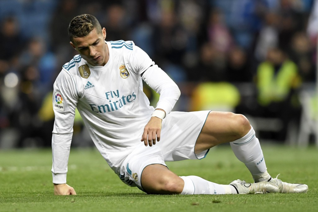 Real Madrid's Portuguese forward Cristiano Ronaldo gets up after falling during the Spanish league football match Real Madrid CF vs UD Las Palmas at the Santiago Bernabeu stadium in Madrid on November 5, 2017. / AFP PHOTO / GABRIEL BOUYS (Photo credit should read GABRIEL BOUYS/AFP/Getty Images)