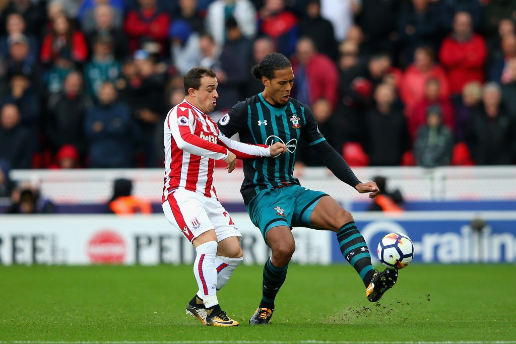 STOKE ON TRENT, ENGLAND - SEPTEMBER 30: Xherdan Shaqiri of Stoke City and Virgil van Dijk of Southampton compete for the ball during the Premier League match between Stoke City and Southampton at Bet365 Stadium on September 30, 2017 in Stoke on Trent, England. (Photo by Alex Livesey/Getty Images)