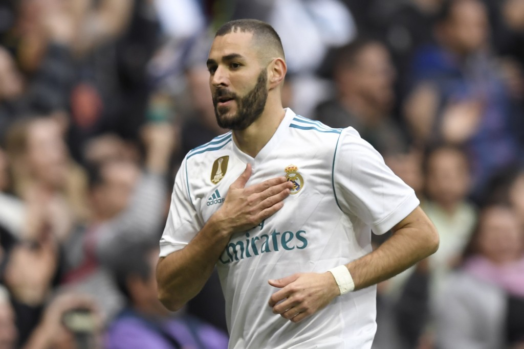 Real Madrid's French forward Karim Benzema celebrates after scoring during the Spanish league football match Real Madrid CF against Malaga CF on 25, November 2017 at the Santiago Bernabeu stadium in Madrid. / AFP PHOTO / GABRIEL BOUYS (Photo credit should read GABRIEL BOUYS/AFP/Getty Images)