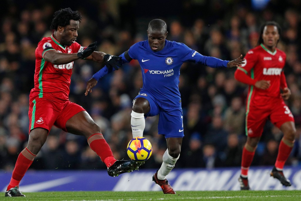 Swansea City's Ivorian striker Wilfried Bony (L) vies with Chelsea's French midfielder N'Golo Kante during the English Premier League football match between Chelsea and Swansea City at Stamford Bridge in London on November 29, 2017. / AFP PHOTO / Adrian DENNIS / RESTRICTED TO EDITORIAL USE. No use with unauthorized audio, video, data, fixture lists, club/league logos or 'live' services. Online in-match use limited to 75 images, no video emulation. No use in betting, games or single club/league/player publications. / (Photo credit should read ADRIAN DENNIS/AFP/Getty Images)