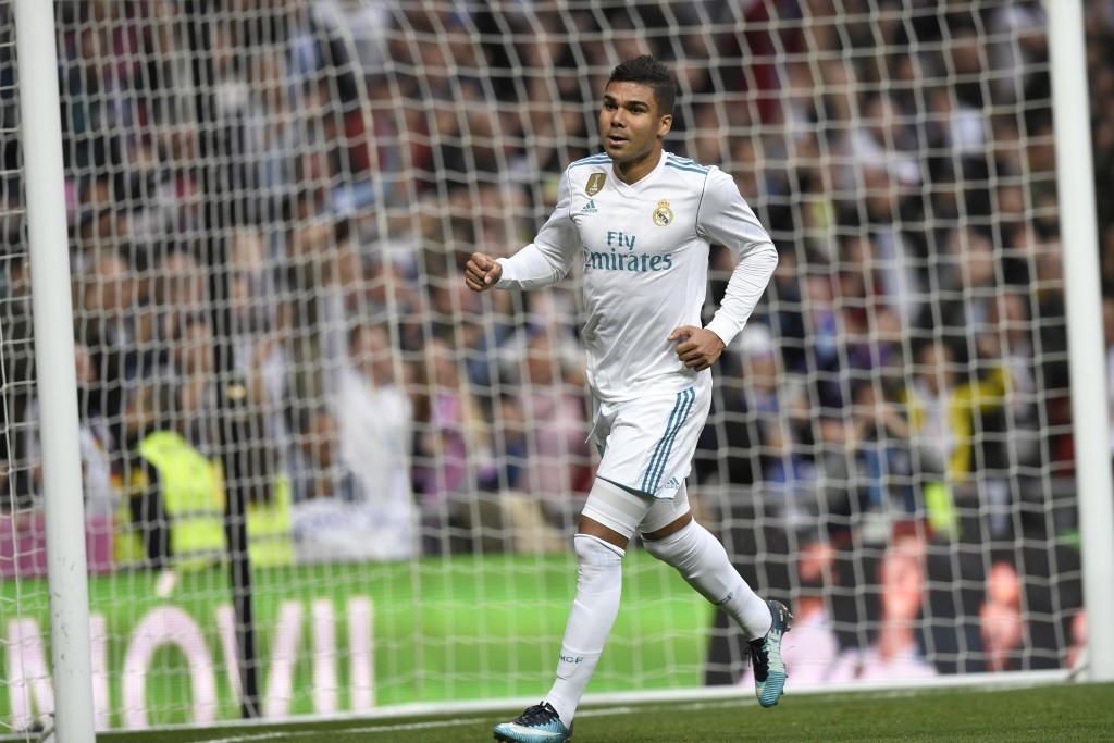 Real Madrid's Brazilian midfielder Casemiro celebrates after scoring during the Spanish league football match Real Madrid CF against Malaga CF on 25, November 2017 at the Santiago Bernabeu stadium in Madrid. / AFP PHOTO / GABRIEL BOUYS (Photo credit should read GABRIEL BOUYS/AFP/Getty Images)