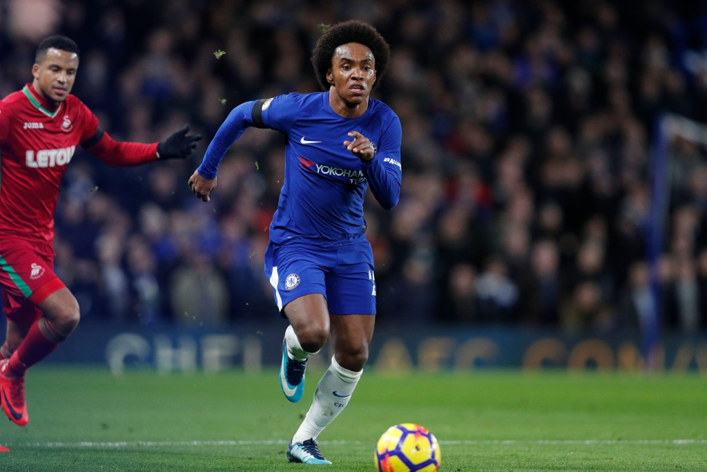Chelsea's Brazilian midfielder Willian runs with the ball during the English Premier League football match between Chelsea and Swansea City at Stamford Bridge in London on November 29, 2017. / AFP PHOTO / Adrian DENNIS / RESTRICTED TO EDITORIAL USE. No use with unauthorized audio, video, data, fixture lists, club/league logos or 'live' services. Online in-match use limited to 75 images, no video emulation. No use in betting, games or single club/league/player publications. / (Photo credit should read ADRIAN DENNIS/AFP/Getty Images)