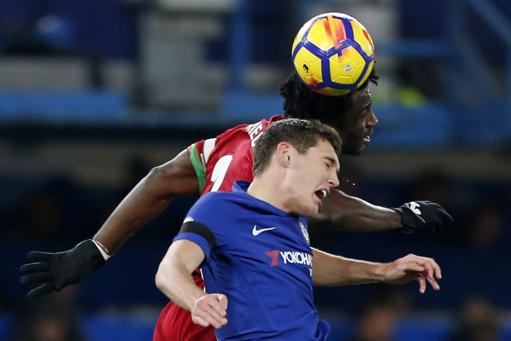 Chelsea's Danish defender Andreas Christensen vies with Swansea City's Ivorian striker Wilfried Bony (R) during the English Premier League football match between Chelsea and Swansea City at Stamford Bridge in London on November 29, 2017. / AFP PHOTO / Ian KINGTON / RESTRICTED TO EDITORIAL USE. No use with unauthorized audio, video, data, fixture lists, club/league logos or 'live' services. Online in-match use limited to 75 images, no video emulation. No use in betting, games or single club/league/player publications. / (Photo credit should read IAN KINGTON/AFP/Getty Images)