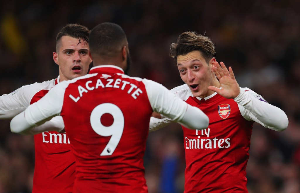 LONDON, ENGLAND - DECEMBER 22: Mesut Ozil of Arsenal (R) celebrates as he scores their third goal with Granit Xhaka and Alexandre Lacazette during the Premier League match between Arsenal and Liverpool at Emirates Stadium on December 22, 2017 in London, England. (Photo by Catherine Ivill/Getty Images)