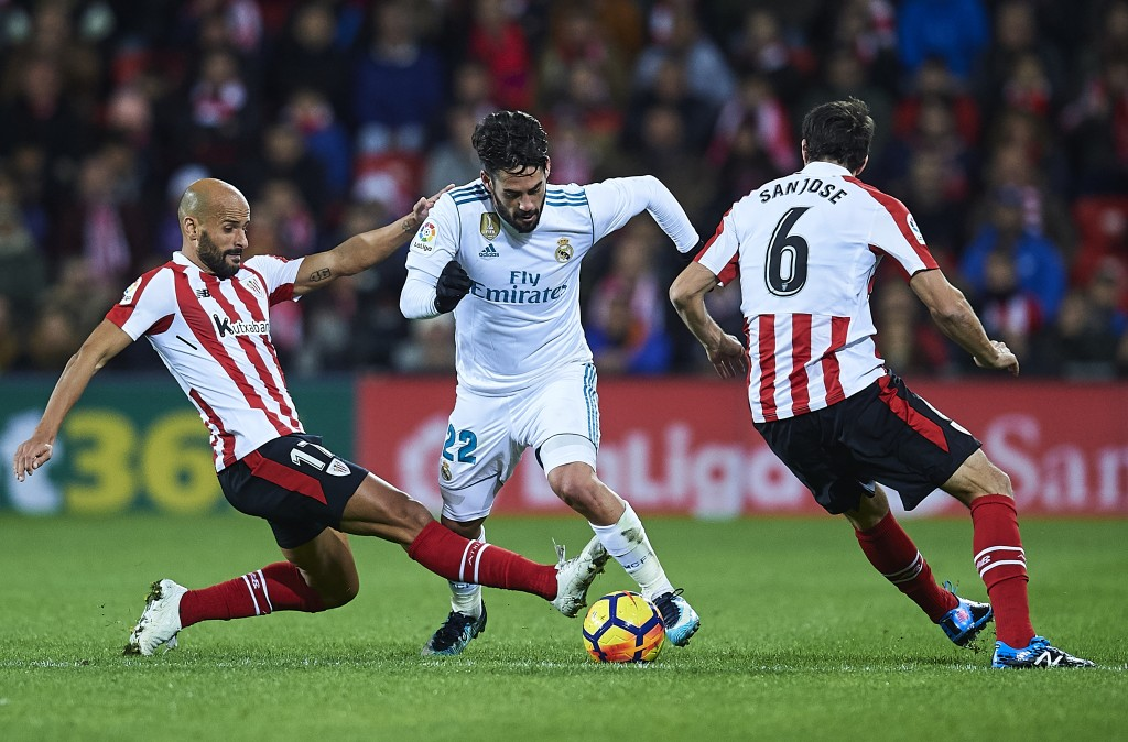 BILBAO, SPAIN - DECEMBER 02: Isco Alarcon of Real Madrid CF being fouled by Mikel Rico of Athletic Club (L) during the La Liga match between Athletic Club and Real Madrid at Estadio de San Mames on December 2, 2017 in Bilbao, Spain. (Photo by Juan Manuel Serrano Arce/Getty Images)