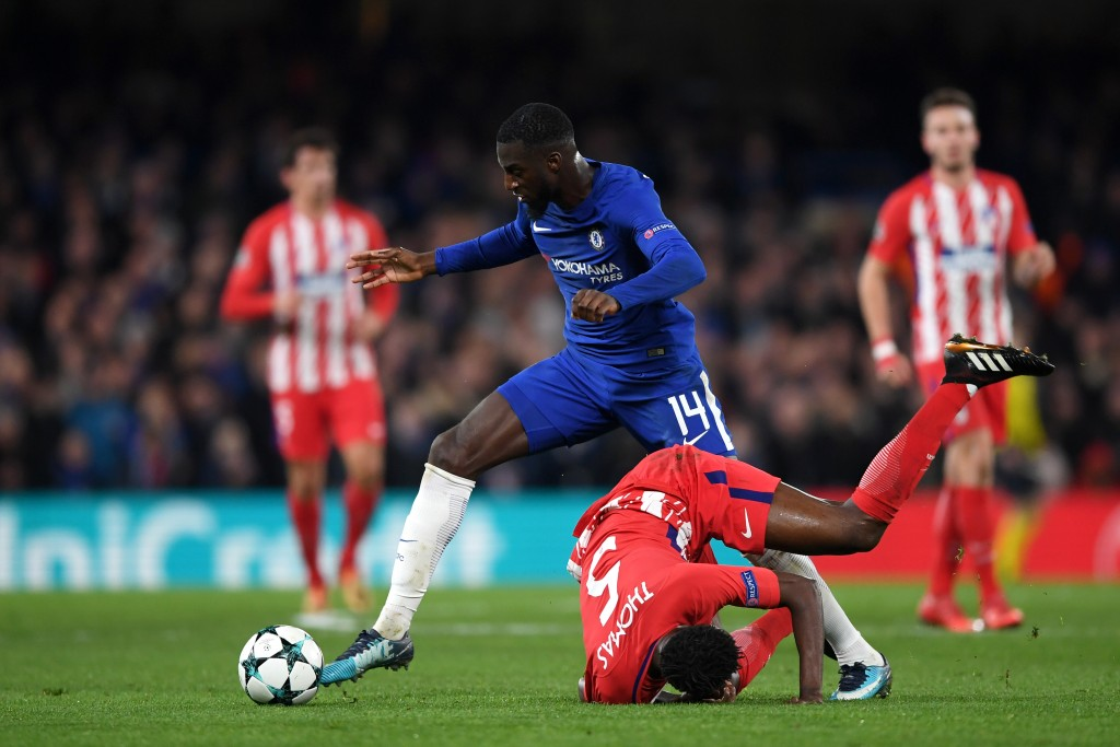 LONDON, ENGLAND - DECEMBER 05: Tiemoue Bakayoko of Chelsea gets away from Thomas Partey of Atletico Madrid during the UEFA Champions League group C match between Chelsea FC and Atletico Madrid at Stamford Bridge on December 5, 2017 in London, United Kingdom. (Photo by Shaun Botterill/Getty Images)