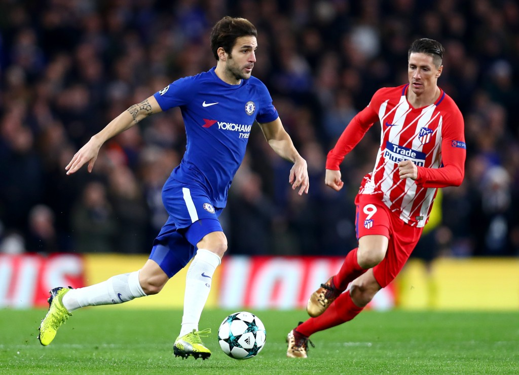 LONDON, ENGLAND - DECEMBER 05: Cesc Fabregas of Chelsea and Fernando Torres of Atletico Madrid in action during the UEFA Champions League group C match between Chelsea FC and Atletico Madrid at Stamford Bridge on December 5, 2017 in London, United Kingdom. (Photo by Clive Rose/Getty Images)