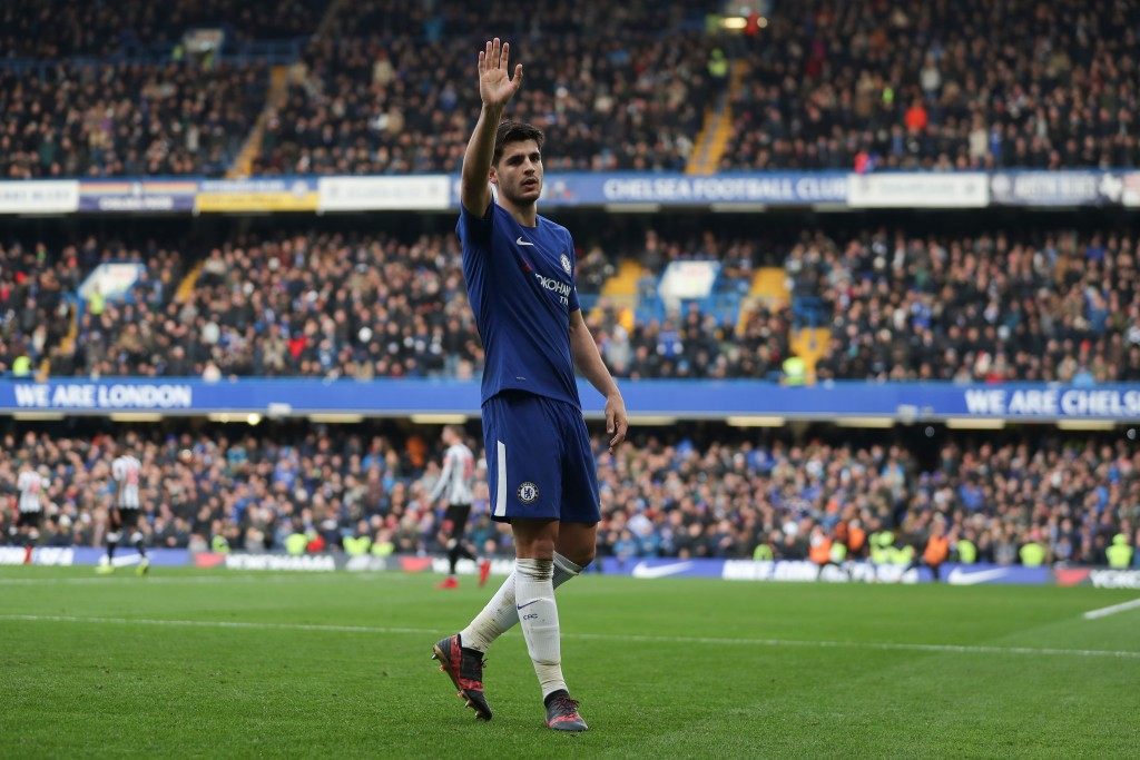 Chelsea's Spanish striker Alvaro Morata celebrates scoring his team's second goal during the English Premier League football match between Chelsea and Newcastle United at Stamford Bridge in London on December 2, 2017. / AFP PHOTO / Daniel LEAL-OLIVAS / RESTRICTED TO EDITORIAL USE. No use with unauthorized audio, video, data, fixture lists, club/league logos or 'live' services. Online in-match use limited to 75 images, no video emulation. No use in betting, games or single club/league/player publications. / (Photo credit should read DANIEL LEAL-OLIVAS/AFP/Getty Images)