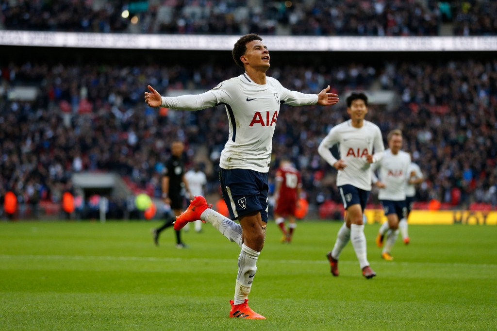 Tottenham Hotspur's English midfielder Dele Alli celebrates after scoring their third goal during the English Premier League football match between Tottenham Hotspur and Liverpool at Wembley Stadium in London, on October 22, 2017. / AFP PHOTO / IKIMAGES / Ian KINGTON / RESTRICTED TO EDITORIAL USE. No use with unauthorized audio, video, data, fixture lists, club/league logos or 'live' services. Online in-match use limited to 45 images, no video emulation. No use in betting, games or single club/league/player publications. / (Photo credit should read IAN KINGTON/AFP/Getty Images)
