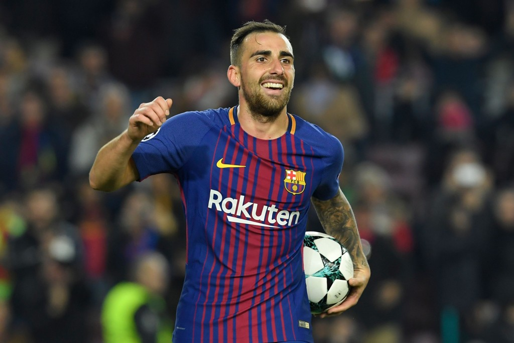 Barcelona's Spanish forward Paco Alcacer celebrates after scoring a second goal during the UEFA Champions League football match FC Barcelona vs Sporting CP at the Camp Nou stadium in Barcelona on December 5, 2017. / AFP PHOTO / LLUIS GENE (Photo credit should read LLUIS GENE/AFP/Getty Images)