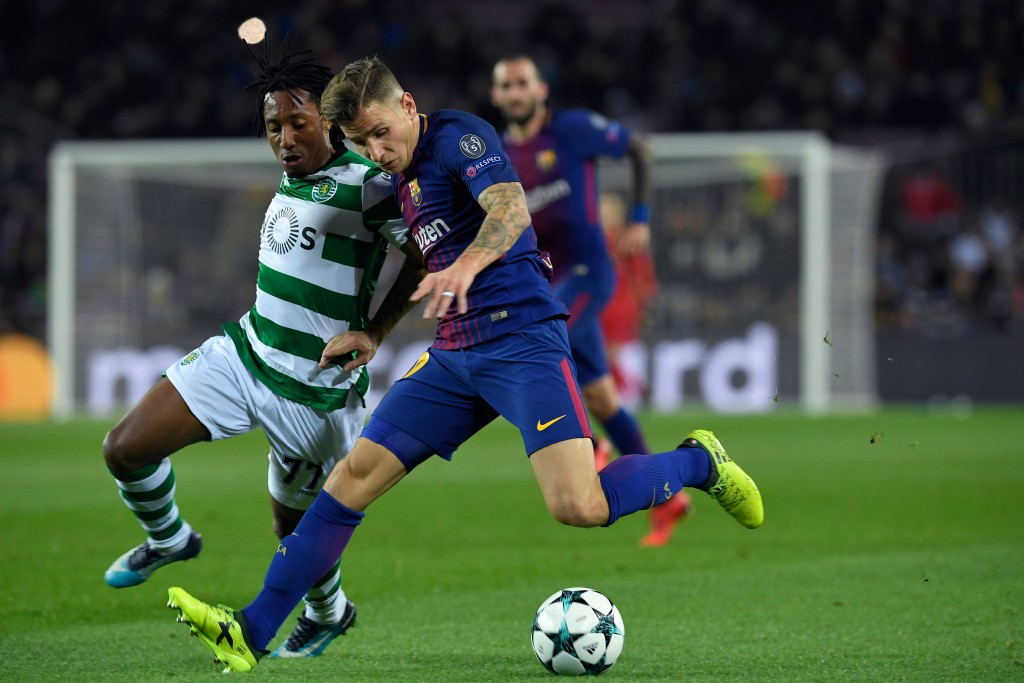 Barcelona's French defender Lucas Digne (R) challenges Sporting's Portuguese forward Gelson Martins during the UEFA Champions League football match FC Barcelona vs Sporting CP at the Camp Nou stadium in Barcelona on December 5, 2017. / AFP PHOTO / LLUIS GENE (Photo credit should read LLUIS GENE/AFP/Getty Images)