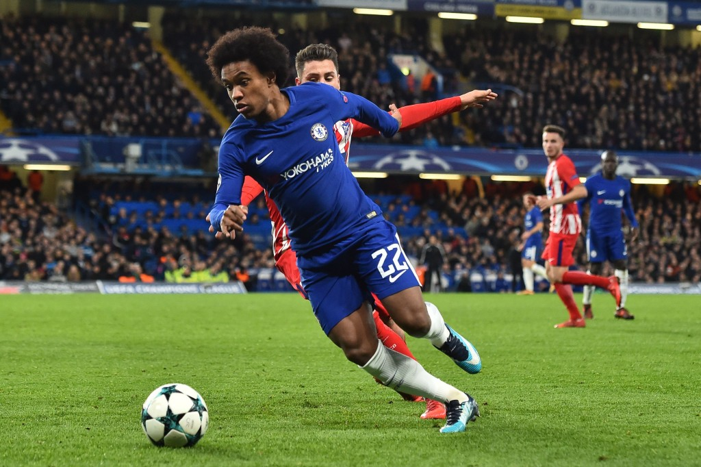 Chelsea's Brazilian midfielder Willian runs during a UEFA Champions League Group C football match between Chelsea and Atletico Madrid at Stamford Bridge in London on December 5, 2017. / AFP PHOTO / Glyn KIRK (Photo credit should read GLYN KIRK/AFP/Getty Images)