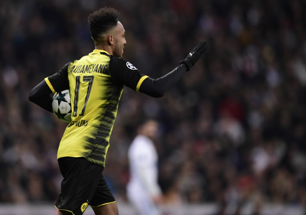 Dortmund's Gabonese forward Pierre-Emerick Aubameyang celebrates a goal during the UEFA Champions League group H football match Real Madrid CF vs Borussia Dortmund at the Santiago Bernabeu stadium in Madrid on December 6, 2017. / AFP PHOTO / JAVIER SORIANO