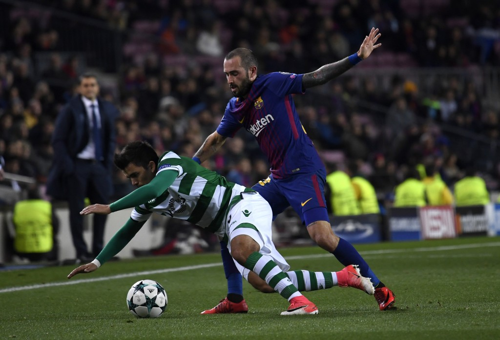 BARCELONA, SPAIN - DECEMBER 05: Marcos Acuna of Sporting Lisbon is challenged by Aleix Vidal of Barcelona during the UEFA Champions League group D match between FC Barcelona and Sporting CP at Camp Nou on December 5, 2017 in Barcelona, Spain. (Photo by Alex Caparros/Getty Images)