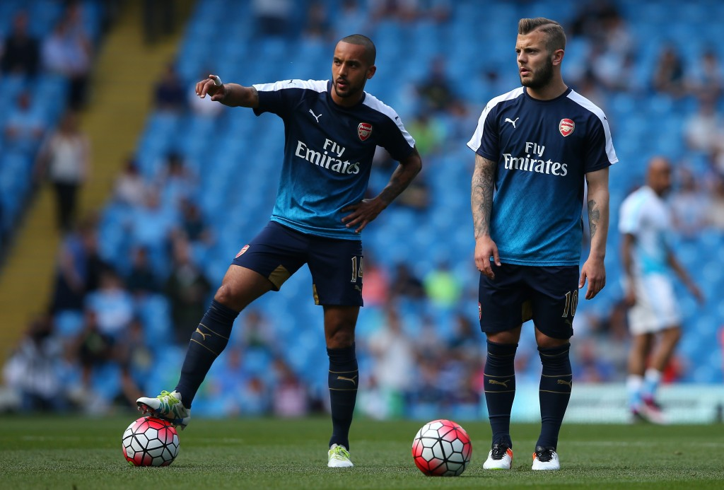 MANCHESTER, ENGLAND - MAY 08: Theo Walcott of Arsenal (L) and Jack Wilshere of Arsenal warm up prior to the Barclays Premier League match between Manchester City and Arsenal at the Etihad Stadium on May 8, 2016 in Manchester, England. (Photo by Alex Livesey/Getty Images)