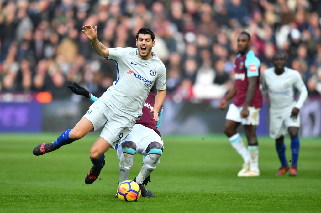 LONDON, ENGLAND - DECEMBER 09: Alvaro Morata of Chelsea is fouled by Pedro Obiang of West Ham United (obscure) during the Premier League match between West Ham United and Chelsea at London Stadium on December 9, 2017 in London, England. (Photo by Dan Mullan/Getty Images) *** Local Caption *** Alvaro Morata