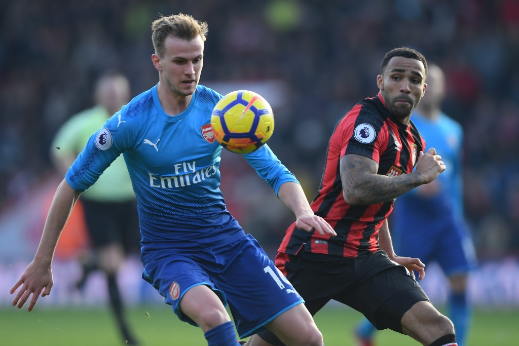 BOURNEMOUTH, ENGLAND - JANUARY 14: Rob Holding of Arsenal is challenged by Callum Wilson of Bournemouth during the Premier League match between AFC Bournemouth and Arsenal at Vitality Stadium on January 14, 2018 in Bournemouth, England. (Photo by Mike Hewitt/Getty Images)