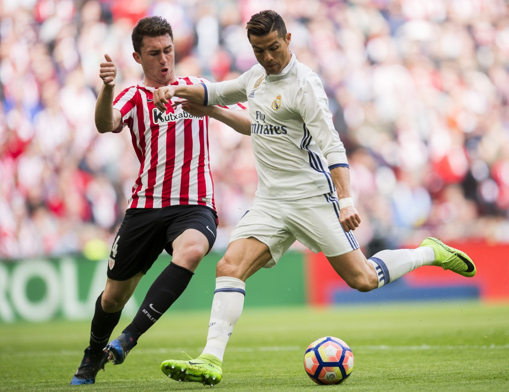 BILBAO, SPAIN - MARCH 18: Cristiano Ronaldo of Real Madrid competes for the ball with Aymeric Laporte of Athletic Club during the La Liga match between Athletic Club Bilbao and Real Madrid at San Mames Stadium on on March 18, 2017 in Bilbao, Spain. (Photo by Juan Manuel Serrano Arce/Getty Images)