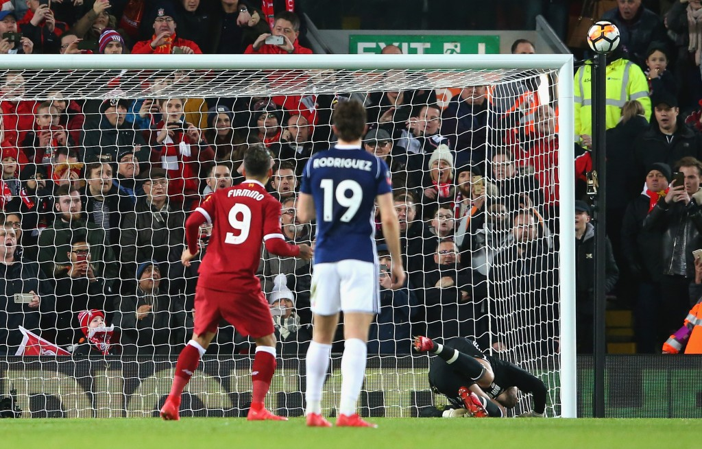 LIVERPOOL, ENGLAND - JANUARY 27: Roberto Firmino of Liverpool watches on as he sees his VAR awarded penalty kick strike the crossbar during The Emirates FA Cup Fourth Round match between Liverpool and West Bromwich Albion at Anfield on January 27, 2018 in Liverpool, England. (Photo by Alex Livesey/Getty Images)