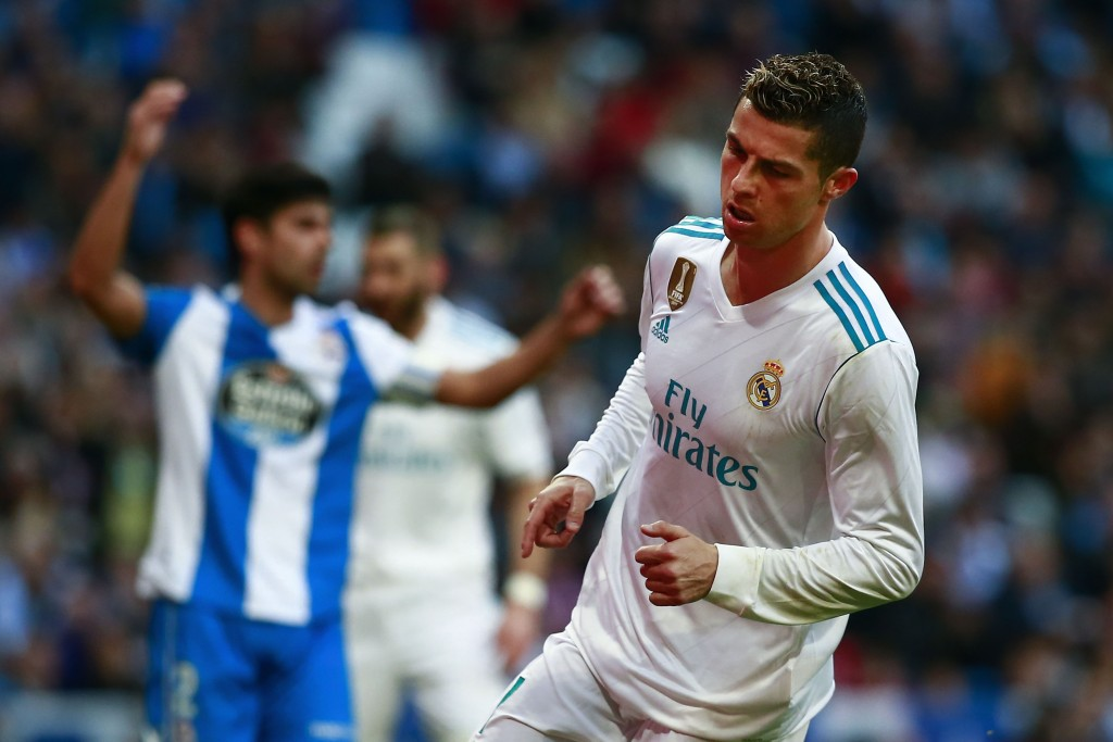 MADRID, SPAIN - JANUARY 21: Cristiano Ronaldo of Real Madrid CF celebrates scoring their fifth goal during the La Liga match between Real Madrid CF and Deportivo La Coruna at Estadio Santiago Bernabeu on January 21, 2018 in Madrid, Spain. (Photo by Gonzalo Arroyo Moreno/Getty Images)