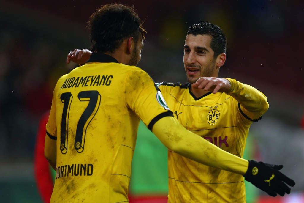 STUTTGART, GERMANY - FEBRUARY 09: Henrikh Mkhitaryan (R) of Dortmund celebrates his team's third goal with team mate Pierre-Emerick Aubameyang during the DFB Cup Quarter Final match between VfB Stuttgart and Borussia Dortmund at Mercedes-Benz Arena on February 9, 2016 in Stuttgart, Germany. (Photo by Alex Grimm/Bongarts/Getty Images)