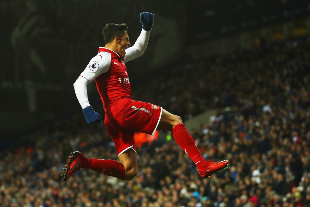 Alexis after scoring a late goal against West Brom in the Premier League