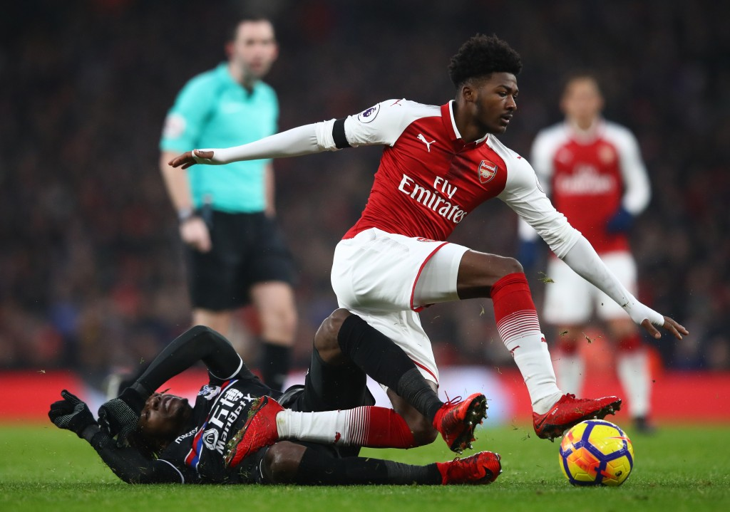 LONDON, ENGLAND - JANUARY 20: Wilfried Zaha of Crystal Palace tackles Ainsley Maitland-Niles of Arsenal during the Premier League match between Arsenal and Crystal Palace at Emirates Stadium on January 20, 2018 in London, England. (Photo by Clive Mason/Getty Images)