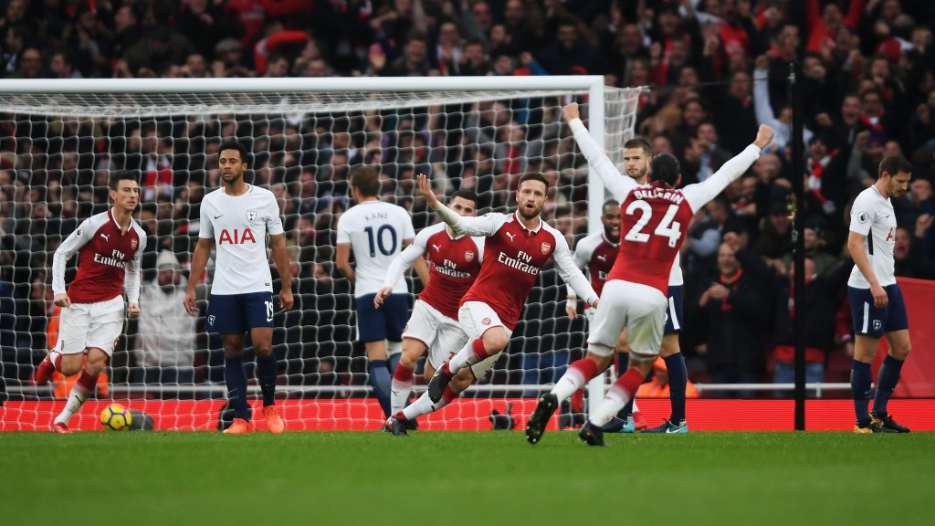 LONDON, ENGLAND - NOVEMBER 18: Shkodran Mustafi of Arsenal celebrates with team mates after scoring his sides first goal during the Premier League match between Arsenal and Tottenham Hotspur at Emirates Stadium on November 18, 2017 in London, England. (Photo by Mike Hewitt/Getty Images)