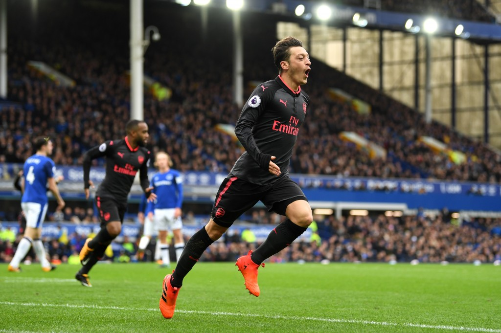 LIVERPOOL, ENGLAND - OCTOBER 22: Mesut Ozil of Arsenal scores his sides second goal during the Premier League match between Everton and Arsenal at Goodison Park on October 22, 2017 in Liverpool, England. (Photo by Gareth Copley/Getty Images)