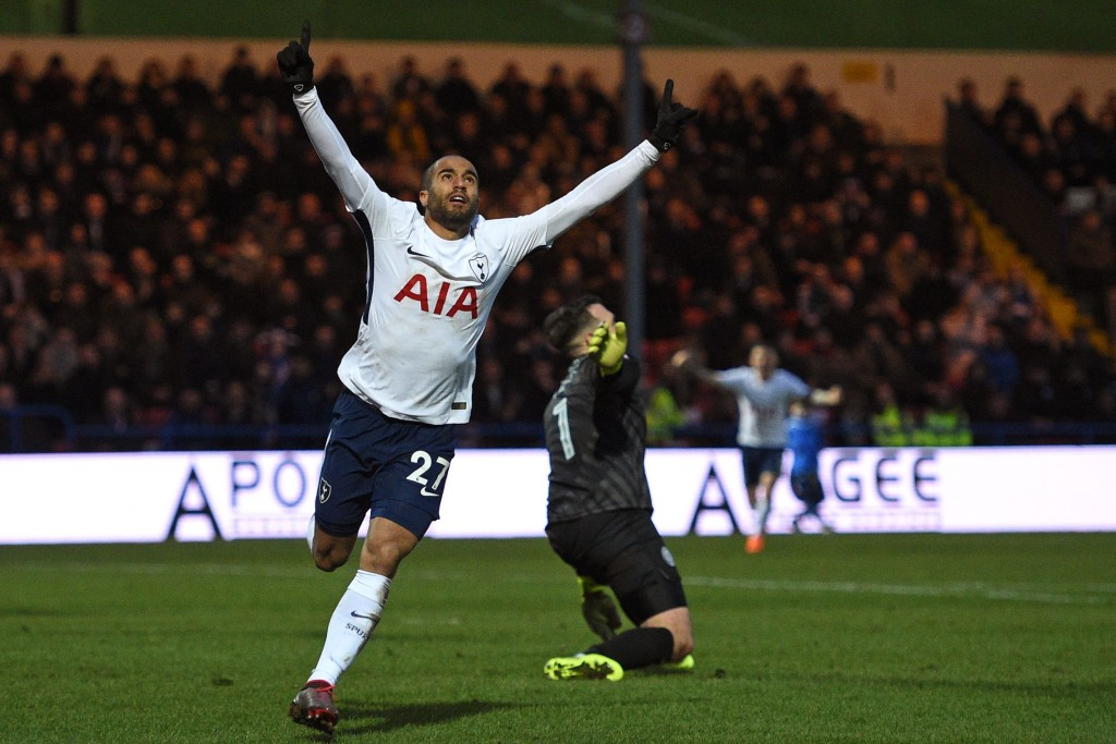 Tottenham Hotspur's Brazilian midfielder Lucas Moura celebrates after scoring their first goal during the English FA Cup fifth round football match between Rochdale and Tottenham Hotspur at the Crown Oil Arena in Rochdale, north west England on February 18, 2018. / AFP PHOTO / Oli SCARFF / RESTRICTED TO EDITORIAL USE. No use with unauthorized audio, video, data, fixture lists, club/league logos or 'live' services. Online in-match use limited to 75 images, no video emulation. No use in betting, games or single club/league/player publications. / (Photo credit should read OLI SCARFF/AFP/Getty Images)