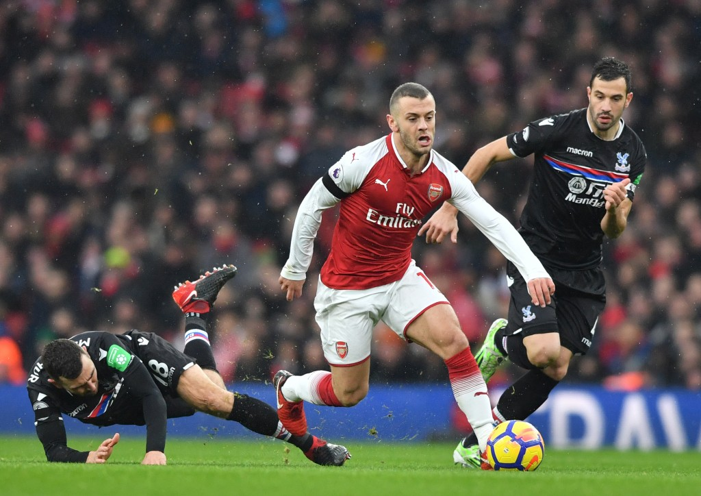 Arsenal's English midfielder Jack Wilshere (C) vies with Crystal Palace's Serbian midfielder Luka Milivojevic (R) during the English Premier League football match between Arsenal and Crystal Palace at the Emirates Stadium in London on January 20, 2018. / AFP PHOTO / Ben STANSALL / RESTRICTED TO EDITORIAL USE. No use with unauthorized audio, video, data, fixture lists, club/league logos or 'live' services. Online in-match use limited to 75 images, no video emulation. No use in betting, games or single club/league/player publications. / (Photo credit should read BEN STANSALL/AFP/Getty Images)