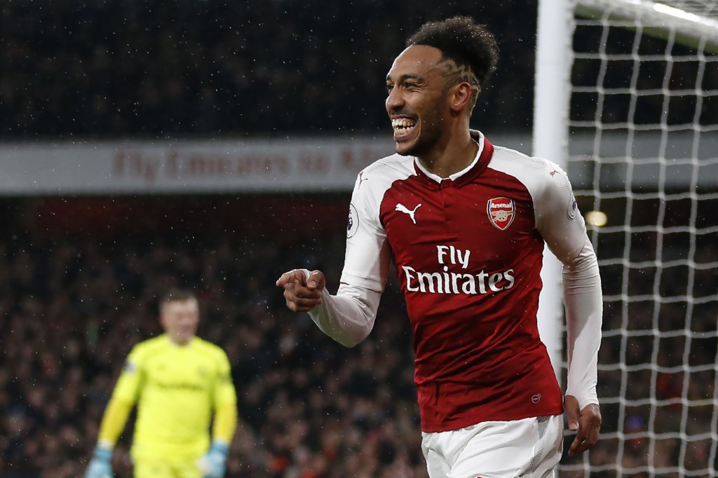 Arsenal's Gabonese striker Pierre-Emerick Aubameyang celebrates scoring the team's fourth goal during the English Premier League football match between Arsenal and Everton at the Emirates Stadium in London on February 3, 2018. / AFP PHOTO / IKIMAGES / Ian KINGTON / RESTRICTED TO EDITORIAL USE. No use with unauthorized audio, video, data, fixture lists, club/league logos or 'live' services. Online in-match use limited to 45 images, no video emulation. No use in betting, games or single club/league/player publications. / (Photo credit should read IAN KINGTON/AFP/Getty Images)