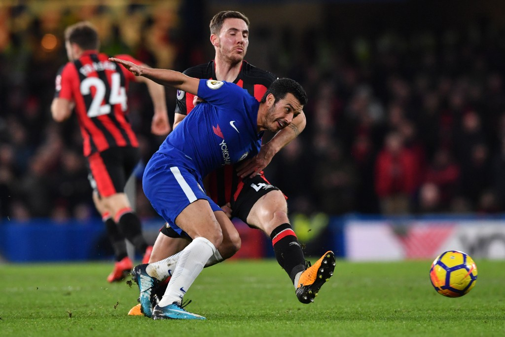 Chelsea's Spanish midfielder Pedro (R) vies with Bournemouth's English midfielder Dan Gosling during the English Premier League football match between Chelsea and Bournemouth at Stamford Bridge in London on January 31, 2018. / AFP PHOTO / Ben STANSALL / RESTRICTED TO EDITORIAL USE. No use with unauthorized audio, video, data, fixture lists, club/league logos or 'live' services. Online in-match use limited to 75 images, no video emulation. No use in betting, games or single club/league/player publications. / (Photo credit should read BEN STANSALL/AFP/Getty Images)