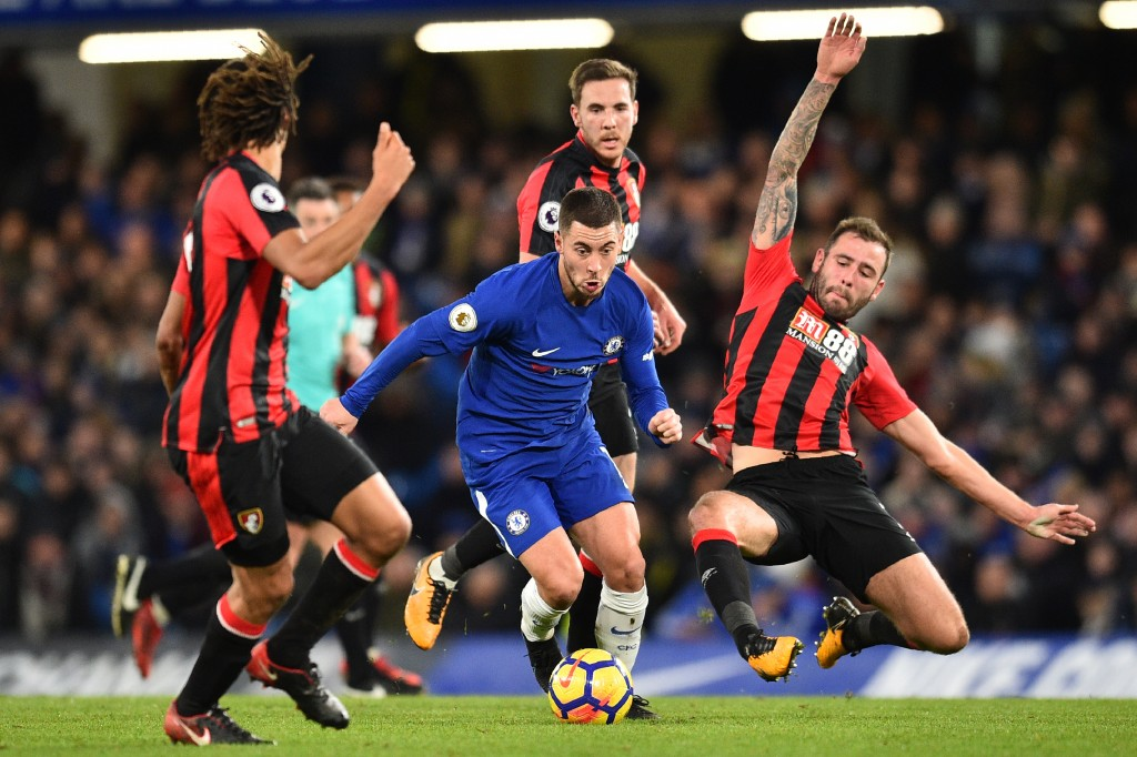 Chelsea's Belgian midfielder Eden Hazard (C) controls the ball during the English Premier League football match between Chelsea and Bournemouth at Stamford Bridge in London on January 31, 2018. / AFP PHOTO / Glyn KIRK / RESTRICTED TO EDITORIAL USE. No use with unauthorized audio, video, data, fixture lists, club/league logos or 'live' services. Online in-match use limited to 75 images, no video emulation. No use in betting, games or single club/league/player publications. / (Photo credit should read GLYN KIRK/AFP/Getty Images)