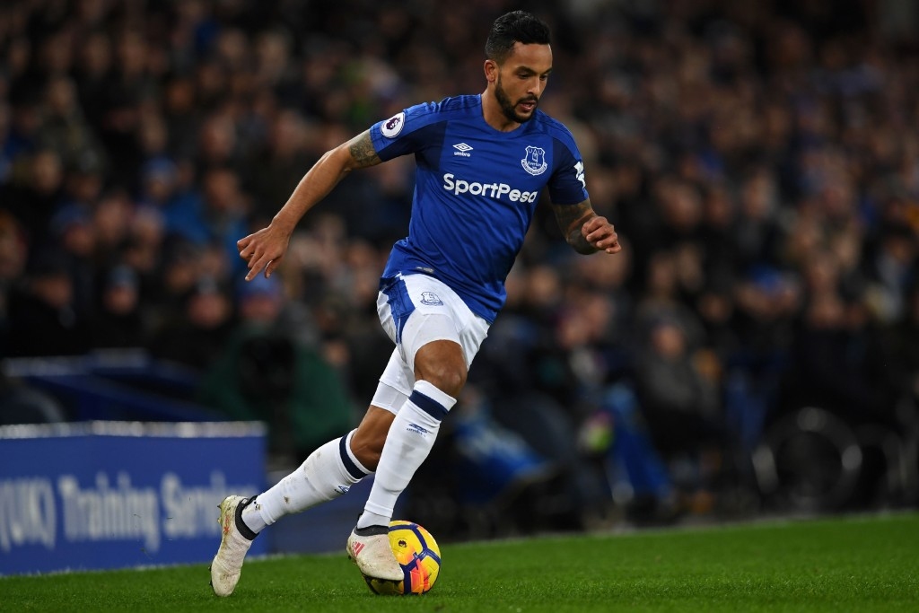 Everton's English striker Theo Walcott runs with the ball during the English Premier League football match between Everton and Leicester City at Goodison Park in Liverpool, north west England on January 31, 2018. / AFP PHOTO / Paul ELLIS / RESTRICTED TO EDITORIAL USE. No use with unauthorized audio, video, data, fixture lists, club/league logos or 'live' services. Online in-match use limited to 75 images, no video emulation. No use in betting, games or single club/league/player publications. / (Photo credit should read PAUL ELLIS/AFP/Getty Images)