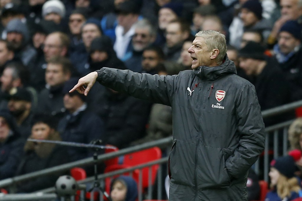 Arsenal's French manager Arsene Wenger gestures from the touchline during the English Premier League football match between Tottenham Hotspur and Arsenal at Wembley Stadium in London, on February 10, 2018. / AFP PHOTO / IKIMAGES / Ian KINGTON / RESTRICTED TO EDITORIAL USE. No use with unauthorized audio, video, data, fixture lists, club/league logos or 'live' services. Online in-match use limited to 45 images, no video emulation. No use in betting, games or single club/league/player publications. / (Photo credit should read IAN KINGTON/AFP/Getty Images)