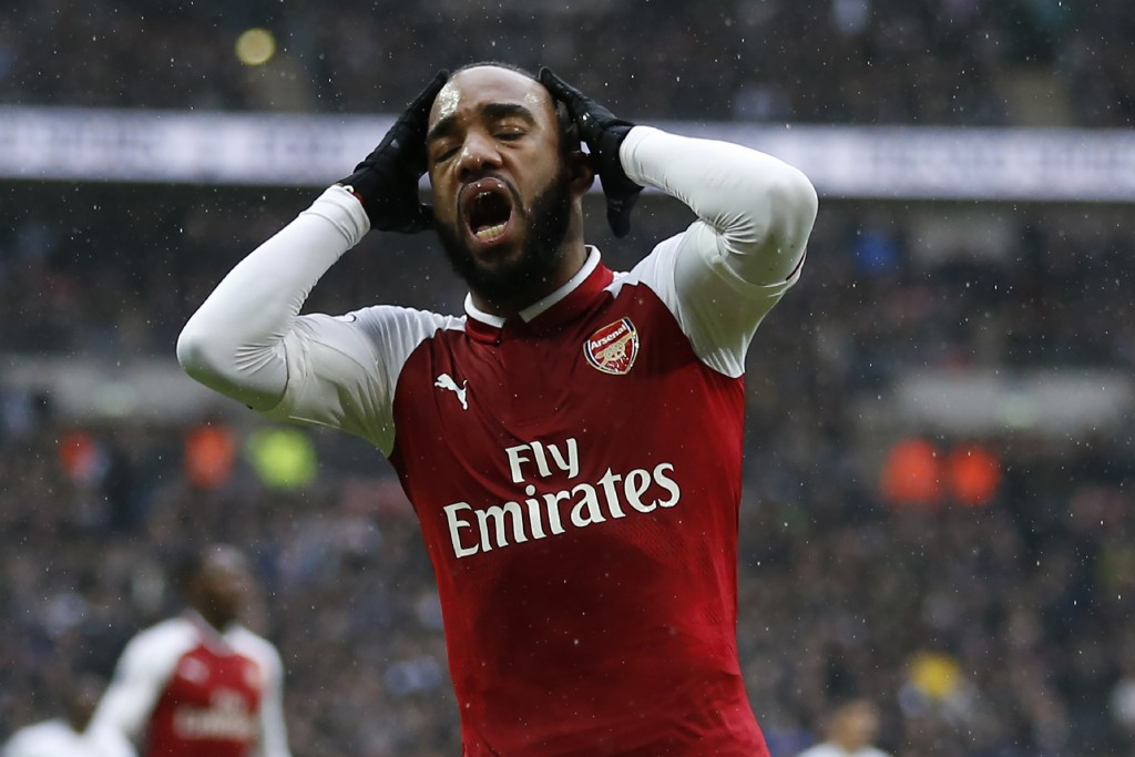 Arsenal's French striker Alexandre Lacazette reacts after missing a chance during the English Premier League football match between Tottenham Hotspur and Arsenal at Wembley Stadium in London, on February 10, 2018. / AFP PHOTO / IKIMAGES / Ian KINGTON / RESTRICTED TO EDITORIAL USE. No use with unauthorized audio, video, data, fixture lists, club/league logos or 'live' services. Online in-match use limited to 45 images, no video emulation. No use in betting, games or single club/league/player publications. / (Photo credit should read IAN KINGTON/AFP/Getty Images)