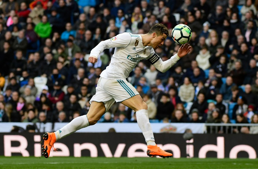 Real Madrid's Portuguese forward Cristiano Ronaldo heads the ball during the Spanish league football match between Real Madrid CF and Deportivo Alaves at the Santiago Bernabeu stadium in Madrid on February 24, 2018. / AFP PHOTO / PIERRE-PHILIPPE MARCOU (Photo credit should read PIERRE-PHILIPPE MARCOU/AFP/Getty Images)