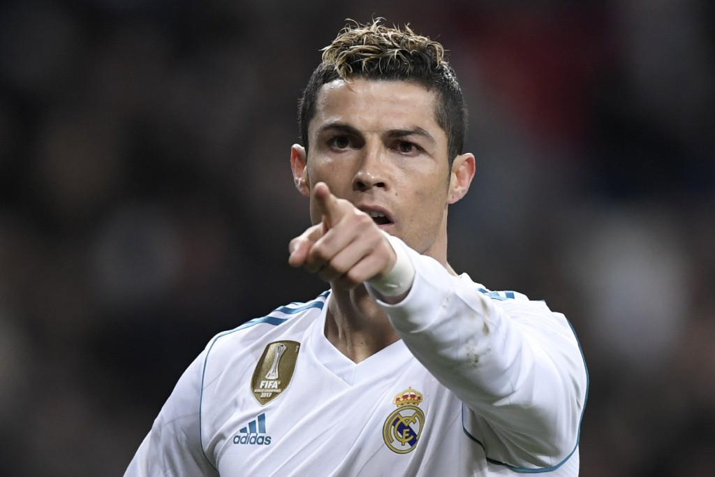 Real Madrid's Portuguese forward Cristiano Ronaldo celebrates after scoring during the Spanish league football match between Real Madrid CF and Real Sociedad at the Santiago Bernabeu stadium in Madrid on February 10, 2018. / AFP PHOTO / GABRIEL BOUYS (Photo credit should read GABRIEL BOUYS/AFP/Getty Images)