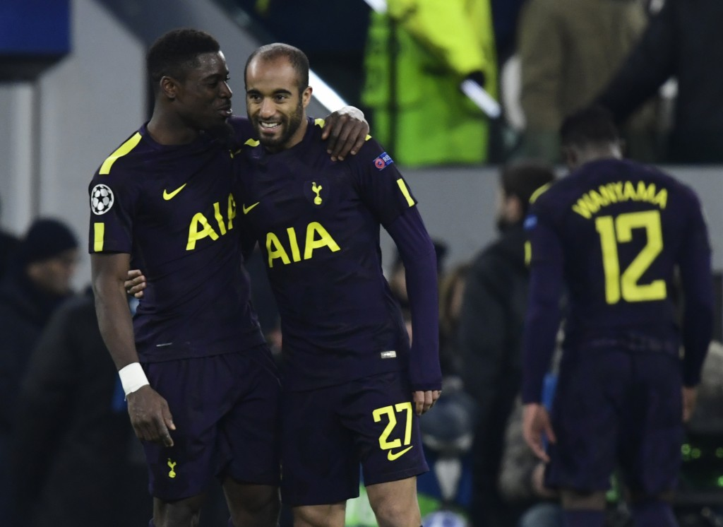 Tottenham Hotspur's Colombian defender Davinson Sanchez (L) embraces teammate Tottenham Hotspur's Brazilian midfielder Lucas after the UEFA Champions League round of sixteen first leg football match between Juventus and Tottenham Hotspur at The Allianz Stadium in Turin on February 13, 2018. / AFP PHOTO / Miguel MEDINA (Photo credit should read MIGUEL MEDINA/AFP/Getty Images)