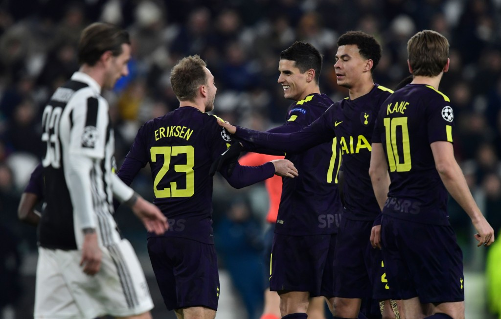Tottenham Hotspur's Danish midfielder Christian Eriksen (C) is congratulated by teammate English midfielder Dele Alli (2R) during the UEFA Champions League round of sixteen first leg football match between Juventus and Tottenham Hotspur at The Allianz Stadium in Turin on February 13, 2018. / AFP PHOTO / Miguel MEDINA (Photo credit should read MIGUEL MEDINA/AFP/Getty Images)