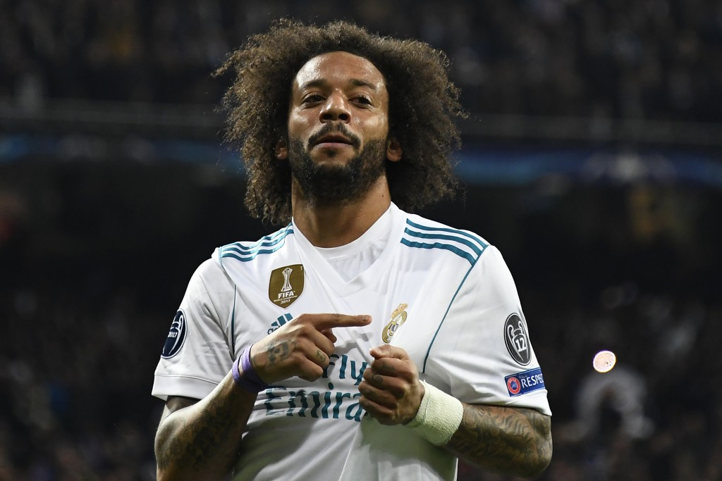Real Madrid's Brazilian defender Marcelo celebrates after scoring during the UEFA Champions League round of sixteen first leg football match Real Madrid CF against Paris Saint-Germain (PSG) at the Santiago Bernabeu stadium in Madrid on February 14, 2018. / AFP PHOTO / GABRIEL BOUYS (Photo credit should read GABRIEL BOUYS/AFP/Getty Images)