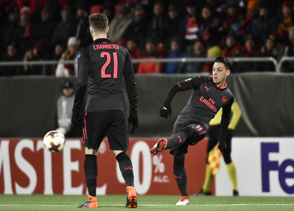 Arsenal's Mesut Özil (R) plays the ball during the UEFA Europa League round of 32, first leg football match of Ostersund FK vs Arsenal FC on February 15, 2018 in Ostersund, Sweden. / AFP PHOTO / TT NEWS AGENCY / Robert HENRIKSSON / Sweden OUT (Photo credit should read ROBERT HENRIKSSON/AFP/Getty Images)